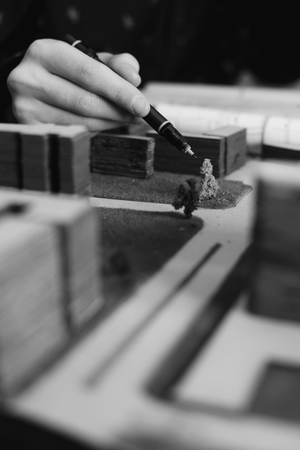 drafting: Architectural project. Building model and drafting tools on construction plan.