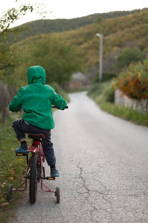 road bike: Boy on bike on country road