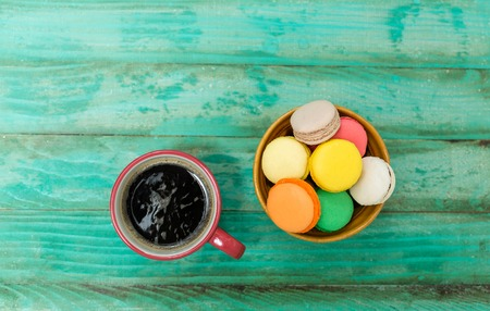 Colorful macaroons and caffee. Stock Photo