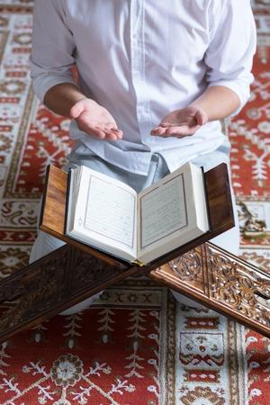 Young Muslim Man Reading The Koran
