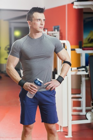 Handsome man exercising at gym Stock Photo