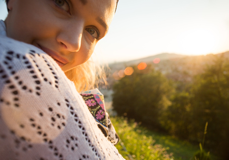 portrait of young beautiful girl is watching susnet in summer environment Stock Photo