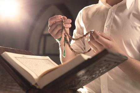 recite: Closeup of Islamic Book Holy Quran