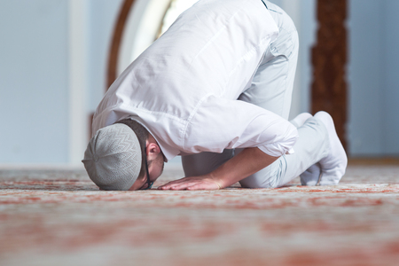 madina: Muslim Man Is Praying In The Mosque Stock Photo