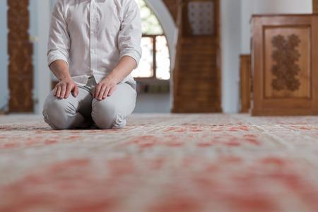 Religious muslim man praying inside the mosque Archivio Fotografico