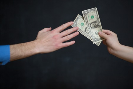 venality: Corruption concept, man taking money from woman Stock Photo