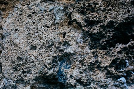 pocketed volcanic tuff rock surface background image
