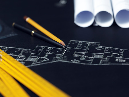 rolled: presenting the blueprint of a new house Stock Photo