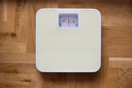 aliments droles: bathroom scale - diet and overweight concept