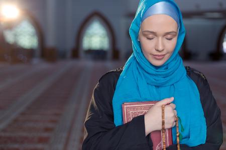 Muslim girl with Holy Book Koran Reklamní fotografie