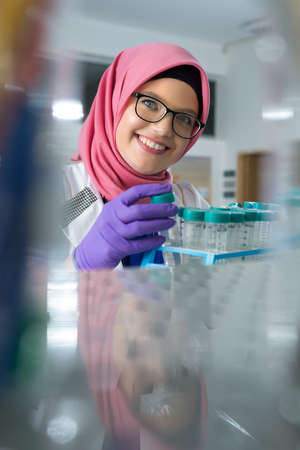 muslim lab worker doing an analysis