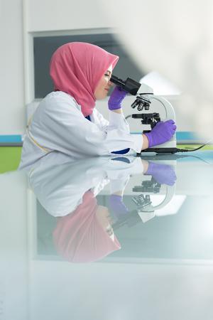 urinalysis: muslim lab worker doing an analysis