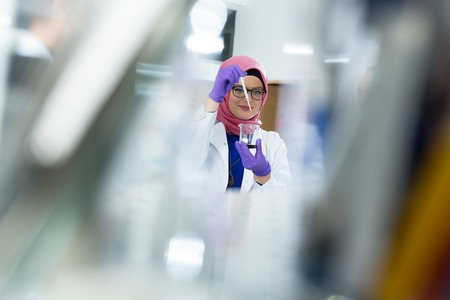 muslim lab worker with hijab or researcher doing an analysis in labaratory Stock Photo
