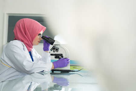 muslim lab worker with hijab or researcher doing an analysis in labaratory Archivio Fotografico