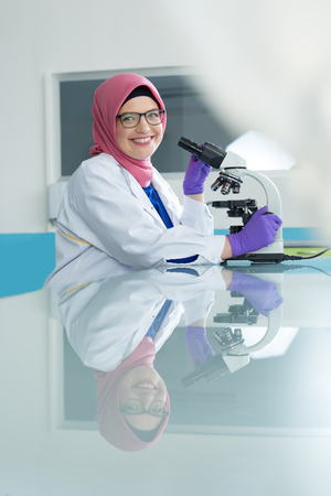 urogenital: muslim lab worker with hijab or researcher doing an analysis in labaratory Stock Photo