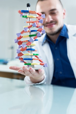 thymine: New technologies in medicine. Scientist and molecule of DNA