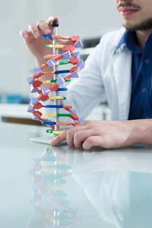 nucleotides: New technologies in medicine. Scientist and molecule of DNA
