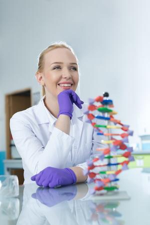 thymine: Woman scientist holding DNA molecule Stock Photo