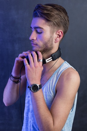 Portrait of young fashion man with headphones