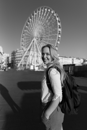 Woman standing in a front of the playing wheel in Marseille in France enjoying the weather. Black and white photography. Stock Photo