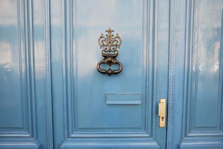 antique door-knocker on old door with beautifull texture Stock Photo