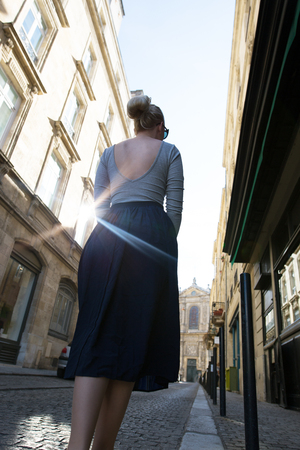 Portrait of a young woman walking in streets Stock Photo