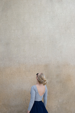 Portrait of a woman against the blank wall. Copy space for your text.