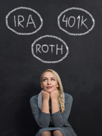 Savings concept. Portrait of woman on chalkboard with different  saving plans