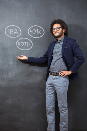 Savings concept. Portrait of man on chalkboard with different  saving plans
