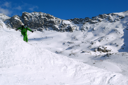 off piste: male is skiing in fresh powder Stock Photo