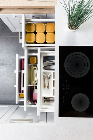 Stock Photo   Top View Of Organized Kitchen Drawers And Electric Kitchen  Stove. Modern Kitchen Organization Of Spaces.