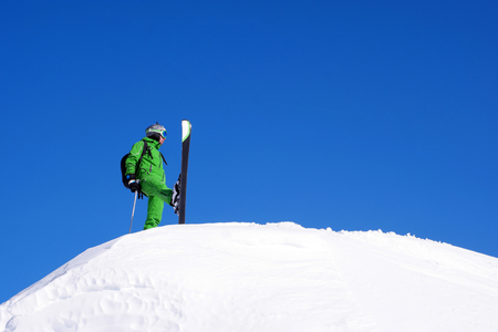 male is skiing in fresh powder Stock Photo