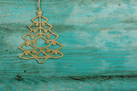 Colourful traditional Christmas decoration  on grunge wood texture of old weathered boards with copyspace Stock Photo