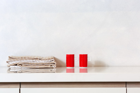 Detail Of Two Cups And Kitchen Rags On A Kitchen Countertop. Stock Photo    82254878