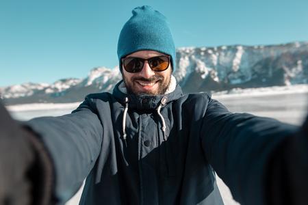 man making selfie on frozen lake Stock Photo