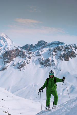 Male skier relaxing on top of the mountain Stock Photo