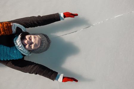 woman enjoying beautiful day on frozen lake Imagens