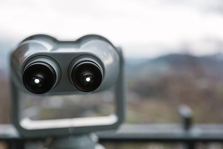 Binocular looking far over the hills  Stock Photo