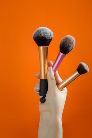 Woman holding an makeup brushes Stock Photo