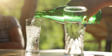 Sipping a sparkling water in the glass