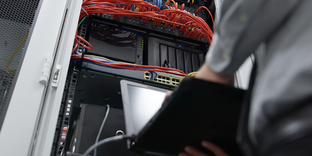 IT expert checking supercomputer server