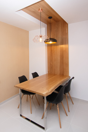 Bright spacious dining room with wooden materials