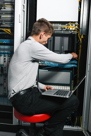young handsome business man engeneer in datacenter server room Imagens - 119092706