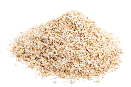Wheat oat on white background. It is common ingredient of healthy meal.
