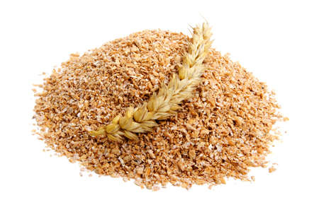 Wheat bran with ears on white background. It is common ingredient of healthy meal.