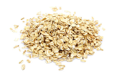 Oat cereal on white background. It is common ingredient of healthy meal. Stock Photo