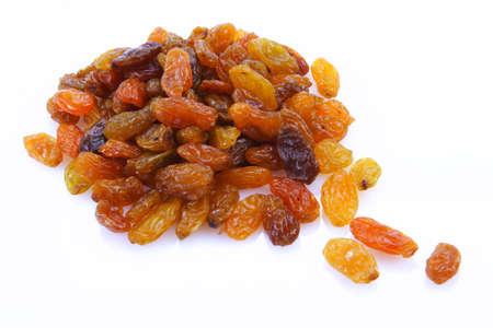 Sweet raisins on white background.