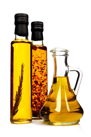 Bottles of aromatic olive oil with rosemary, chilli pepper and pure olive oil.
