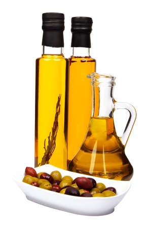 Olive oil bottles: with rosemary, chilli pepper and bottle of pure olive oil. Bowl of mixed olives: black and green.