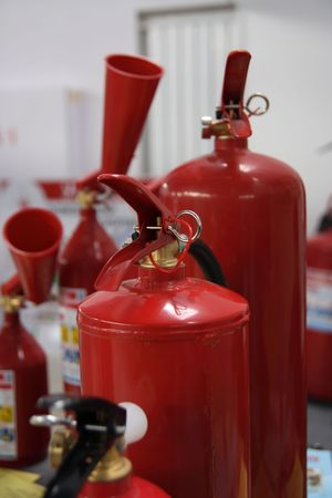 Some fire extinguishers of various capacity. Stock Photo